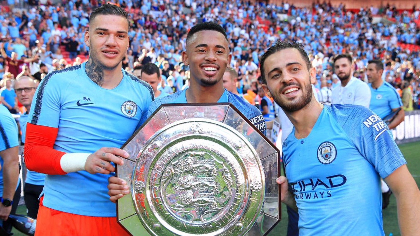 2018: Ederson, Gabriel Jesus and Bernardo Silva celebrate last season's Community Shield success.