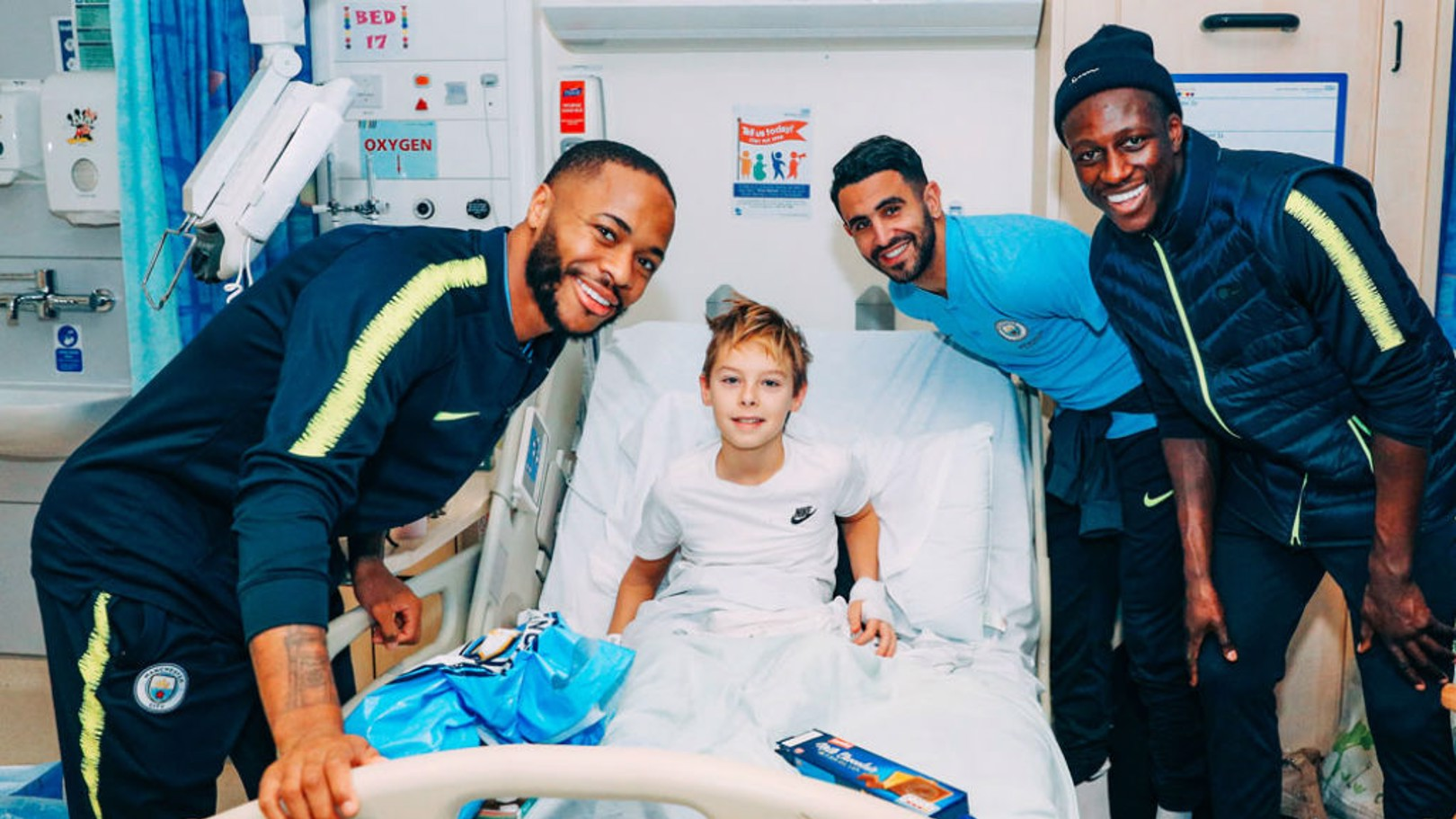 SEASONS GREETINGS: Raheem Sterling, Riyad Mahrez and Benjamin Mendy meet one of the many brave youngsters