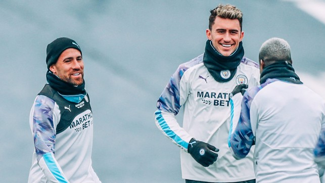 LAPPING IT UP : Aymeric Laporte shares a smile with Benjamin Mendy and Nicolas Otamendi