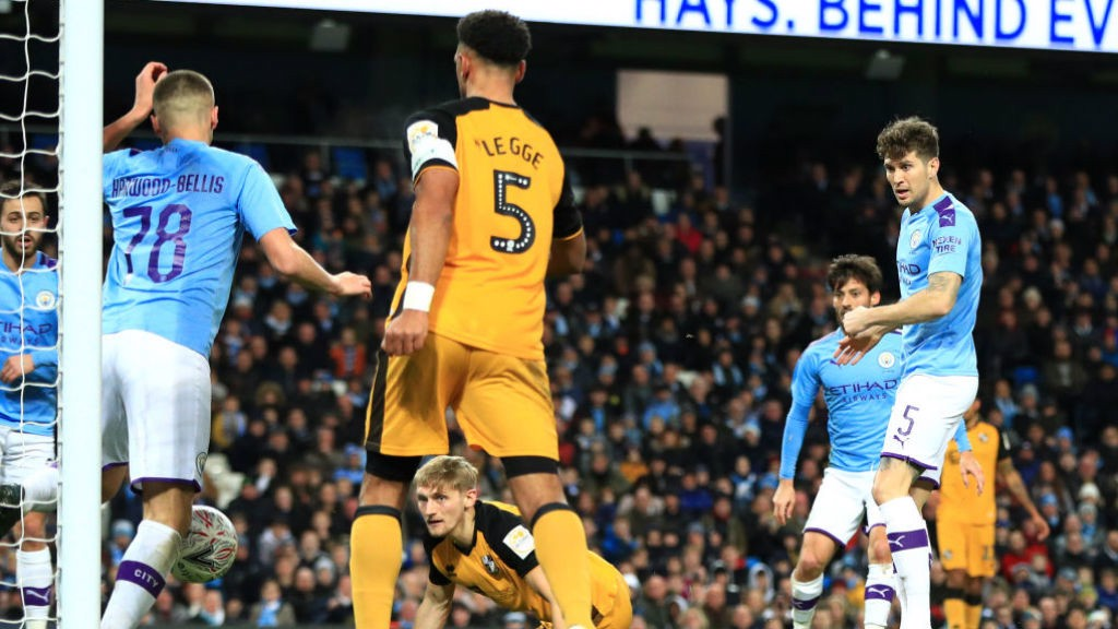 THREE CHEERS : Taylor Harwood-Bellis deflects home John Stones' shot for City's third goal