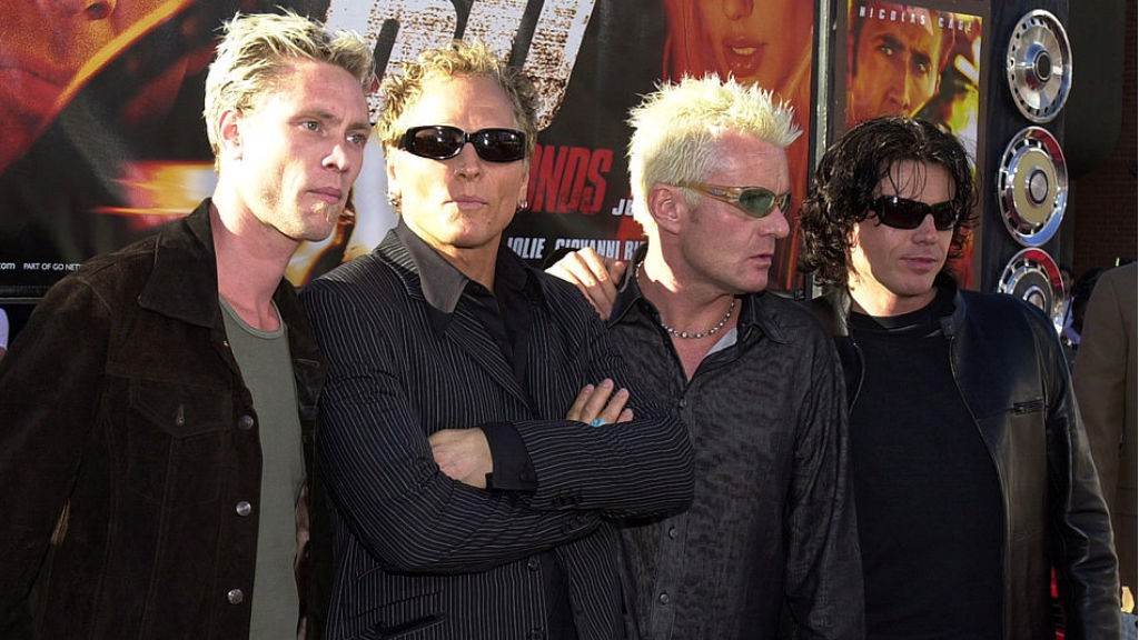 HOLLYWOOD LIFE : Billy (second right) with fellow members of the Cult at an LA film premiere back in 2000