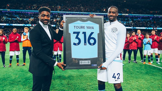 CLUB LEGEND : Receiving his parting gift from brother Kolo