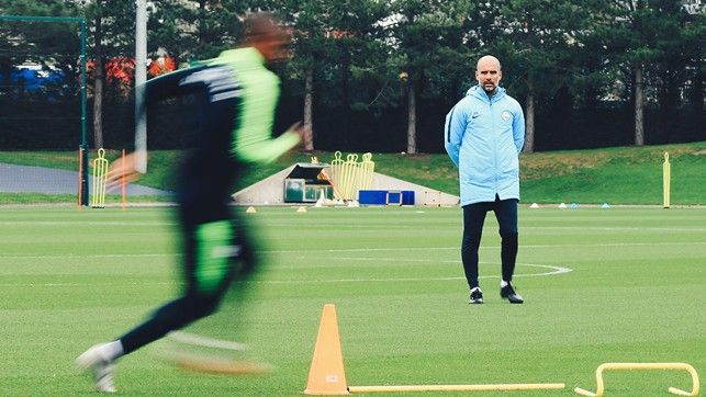 WATCHING BRIEF : Pep Guardiola casts a careful eye over proceedings