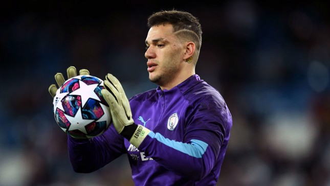 SAFE HANDS: Ederson warms the gloves before kick-off