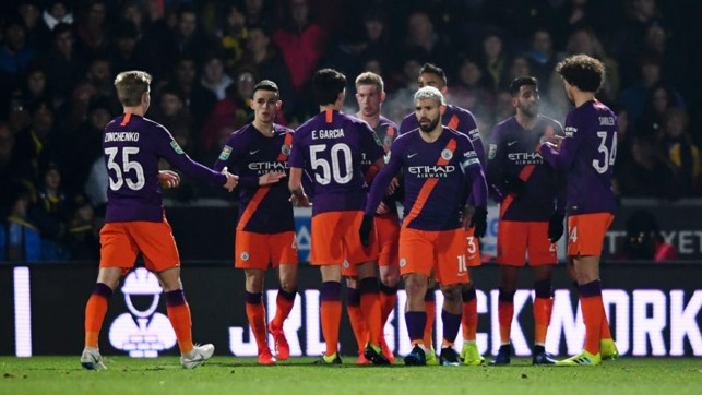 DEADLOCK BROKEN : The team celebrate following Sergio Aguero's opening goal of the game