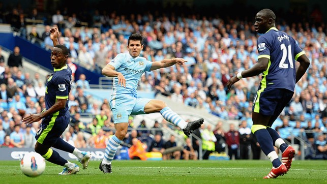UP AND RUNNING : Sergio Aguero slams home his first hat-trick for the Club against Wigan in 2011
