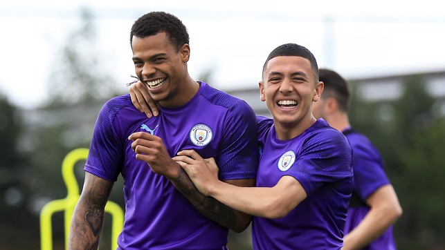 SMILE LIKE YOU MEAN IT : Lukas Nmecha and Ian Poveda enjoy a joke