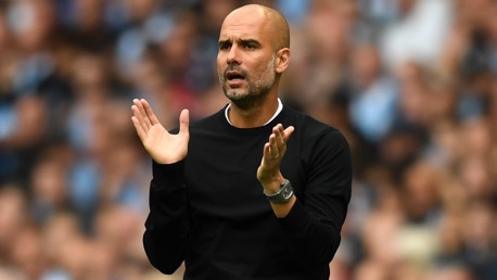 IMPRESSED: Pep Guardiola, enjoying what he's seeing