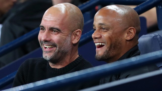 DOUBLE ACT : Pep Guardiola and Vincent Kompany are glad to see a late draw