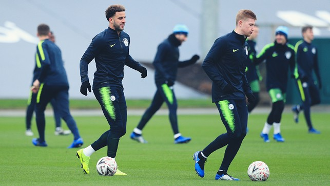 TWO'S COMPANY : Kyle Walker and Kevin De Bruyne limber up for action