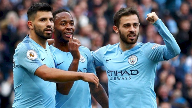 1-0 CITY : The boys celebrate Sterling's opener