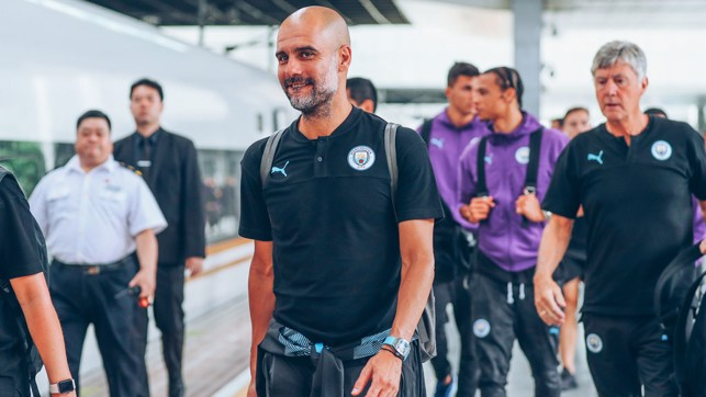 THE BOSS : Pep looks relaxed as he boards the train to Nanjing.