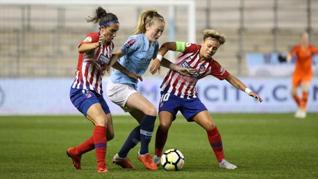 WALSH: Keira takes on the Atletico duo.