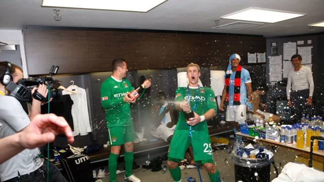 CELEBRATIONS : Excitement in the dressing room after City's FA Cup win in 2011.