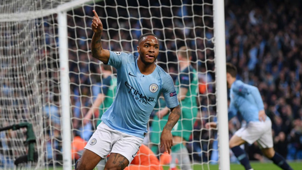THREE CHEERS : Raheem Sterling wheels away in triumph after netting his second and City's third goal