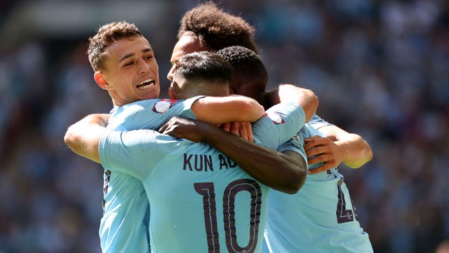 ALL SMILES : Phil Foden leads the celebrations after Sergio Aguero netted his 200th goal for City