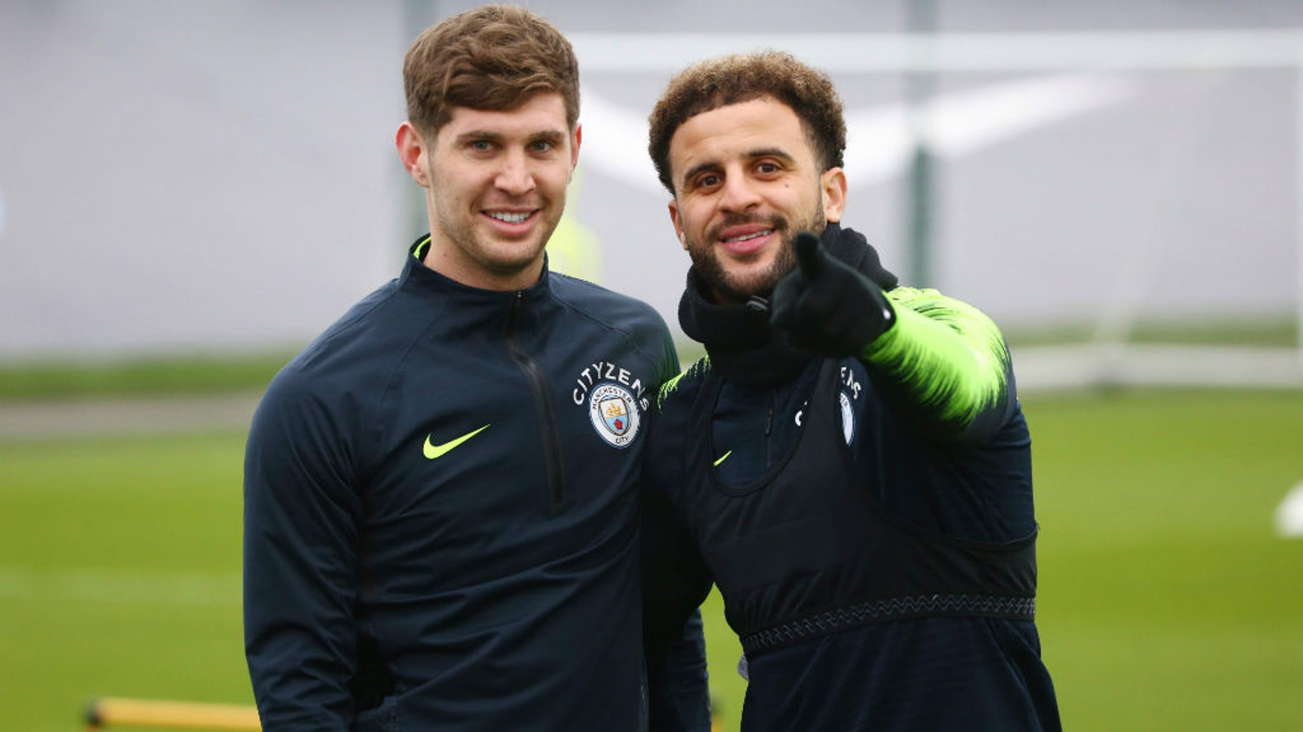 RUMBLED: Kyle Walker and John Stones notice the camera