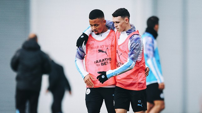 PHILLING IN THE GABS : An arm round the shoulder for Phil Foden and Gabriel Jesus