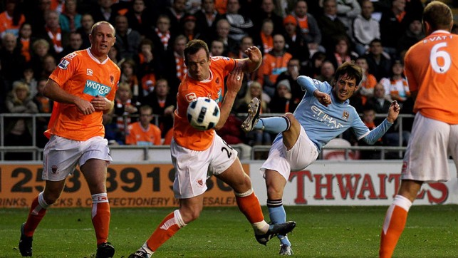 FIRST GOAL : It didn't take long for the Spaniard to net his first City goal, Silva scored and assisted during City's 3-2 win away at Blackpool in October 2010.