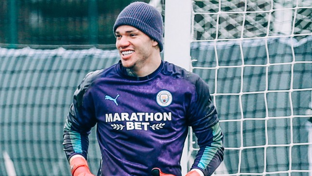 HATS THE WAY TO DO IT: Ederson sports some nifty headwear!