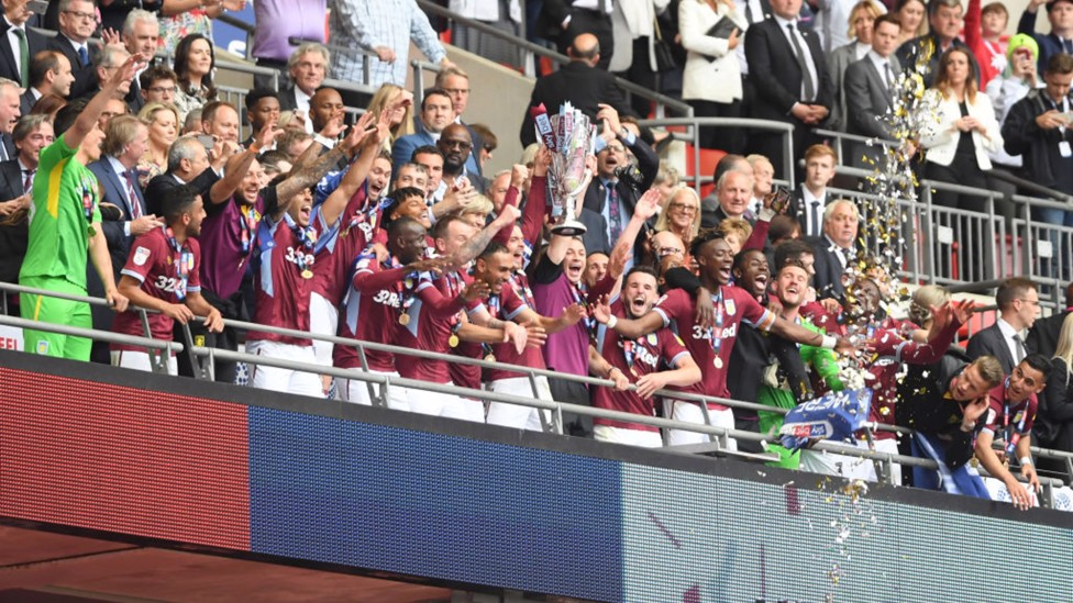 PREMIER LEAGUE BOUND: Jack leads Aston Villa back to the top flight in May 2019 after a 2-1 play-off final victory over Derby County