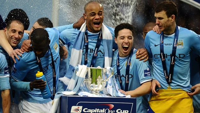 ALL SMILES : The team prepare to lift the League Cup trophy in 2014