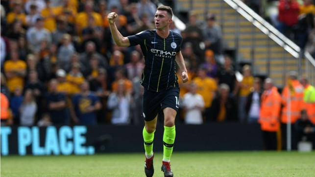 FORWARD MARCH : Laporte salutes the City fans after his thunderous header at Molineux