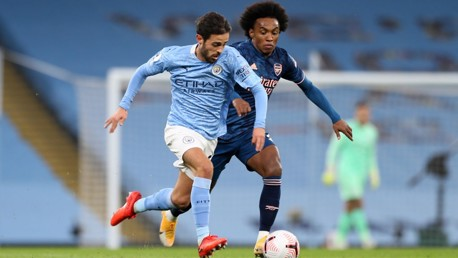 SLIPPERY SILVA: Bernardo escapes out of the clutches of the chasing Willian.