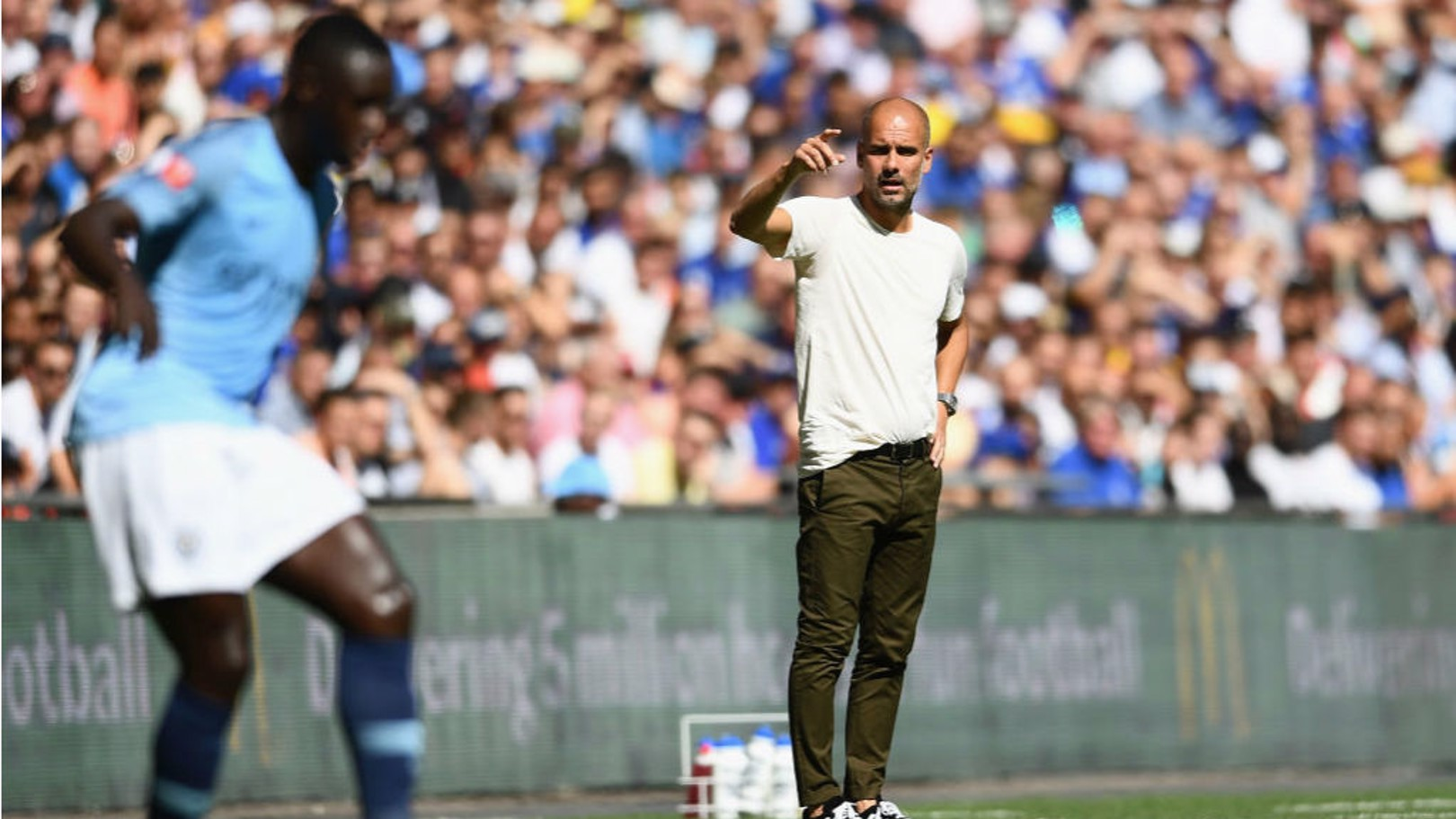PEP TALK: City boss Pep Guardiola passes on instructions to Benjamin Mendy