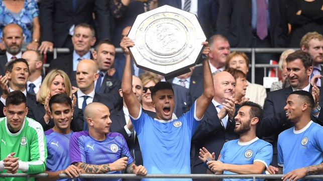 PERFECT START : Rodri lifts his first trophy with City.