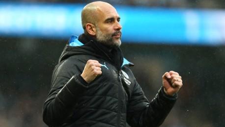 FIST PUMP: Guardiola celebrates City's second goal at the Etihad.