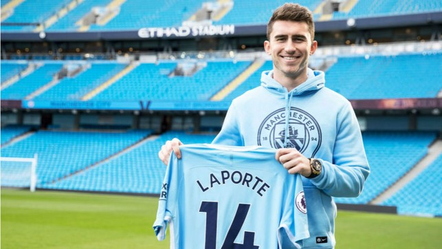 TRUE BLUE : Aymeric Laporte proudly displays his City shirt after completing his move to the Club