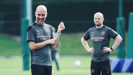 WATCHING BRIEF: Manager Pep Guardiola was in great spirits as he watched over Tuesday's session