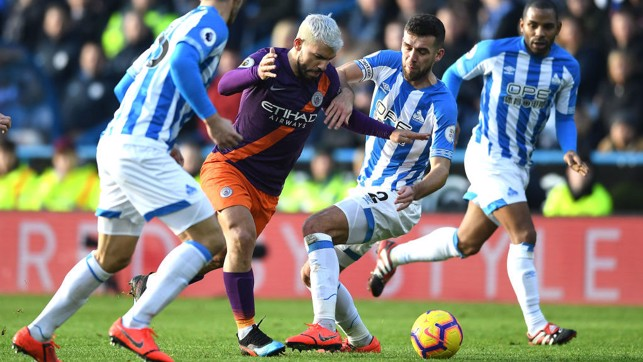 PERSISTENCE : Sergio muscles his way through the Terriers' defence