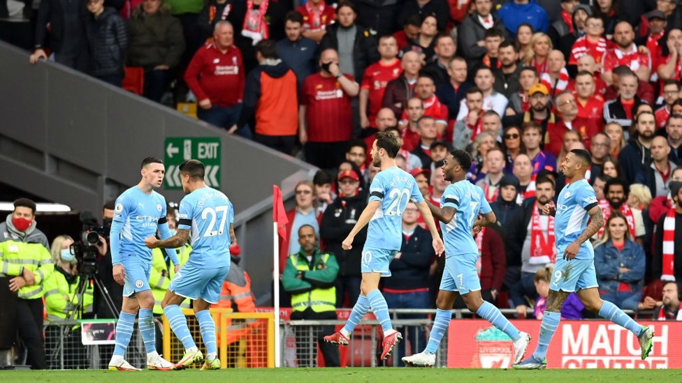 STAR MAN : The players rush to Foden to celebrate his superb equaliser.