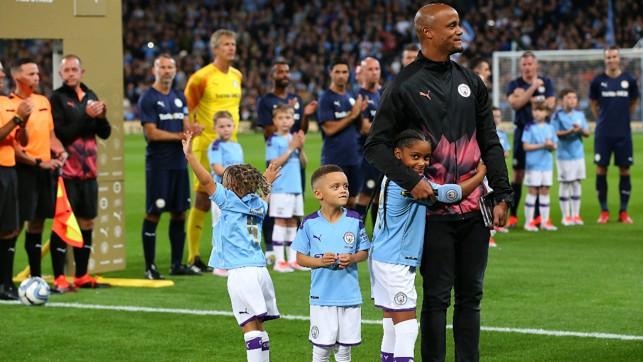 FAMILY FIRST : Kompany gives an emotional opening with his children by his side