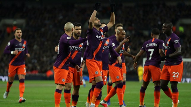 SQUAD : City celebrate after Mahrez bags his fifth goal for the club.