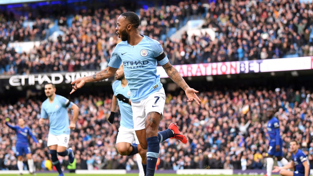 QUICK FIRE : Raheem sterling wheels away after firing City into an early lead v Chelsea