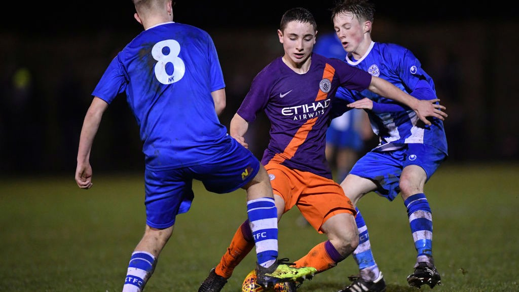 ACTION STATIONS : Joe Hodge looks to weave his way through the Clevedon Town midfield