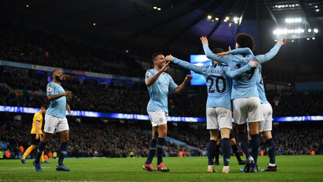 HUGS FOR ALL : Gabriel Jesus celebrates his opening goal of the game with his City team mates