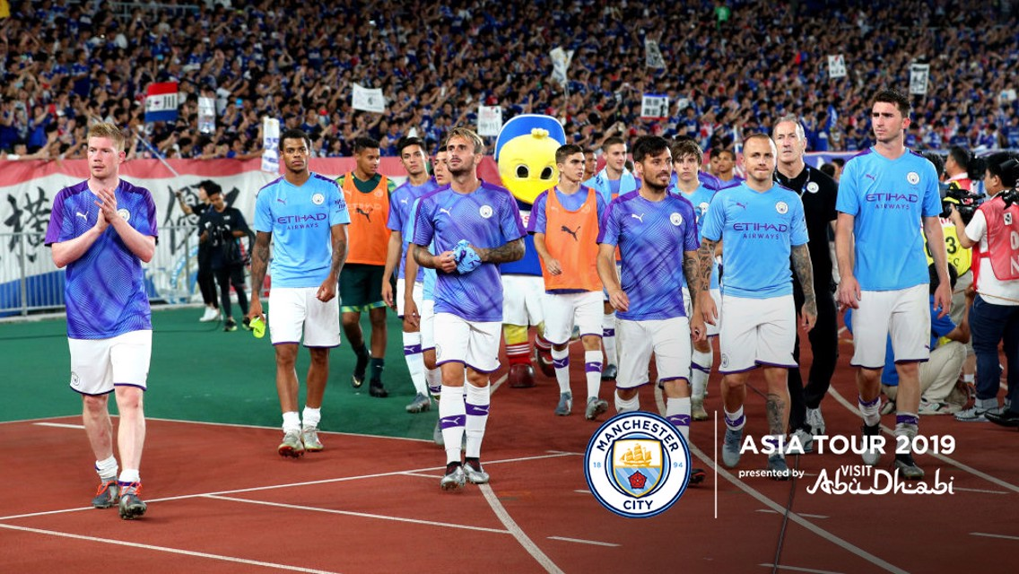 LAP OF HONOUR: City salute fans in Yokohama.