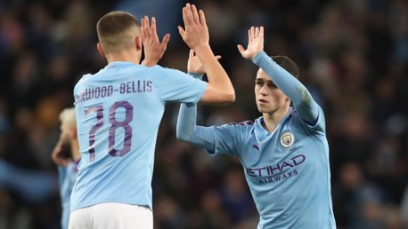 HIGH FIVE: Phil Foden and Taylor Harwood-Bellis celebrate against Port Vale.