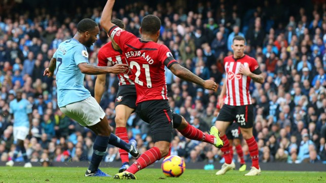 STER CRAZY : Raheem Sterling drills home City's fourth goal on the stroke of half-time