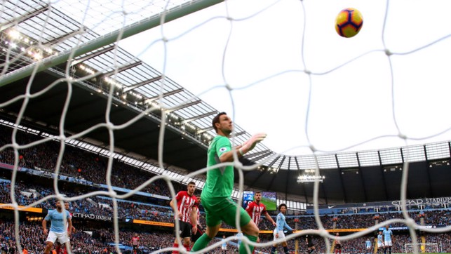 NET GAIN : Saints keeper Alex McCarthy can only look on as David Silva's shot nestles in the back of the net