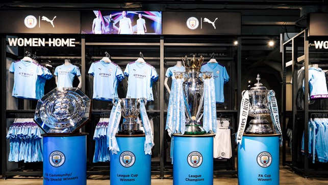 AWESOME FOURSOME : The Community Shield, Carabao Cup, Premier League trophy and FA Cup are also on display following City's historic Fourmidable campaign of last season