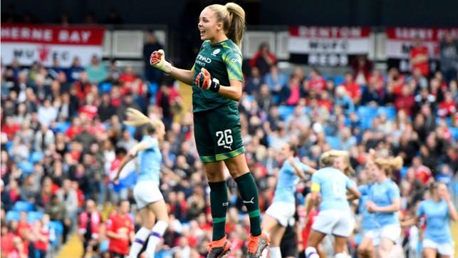 JUMPING FOR JOY : Goalkeeper Ellie Roebuck joins in the celebrations after Caroline Weir's goal