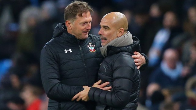 RESPECT : A warm embrace at full-time between the managers.
