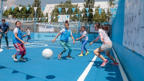 ACTION STATIONS: Youngsters in Mexico City play on the pitch which was opened by Young Leaders