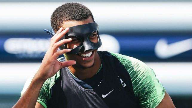 MASKED BALL : Lukas Nmecha has some fun and games with Ilkay Gundogan's protective mask