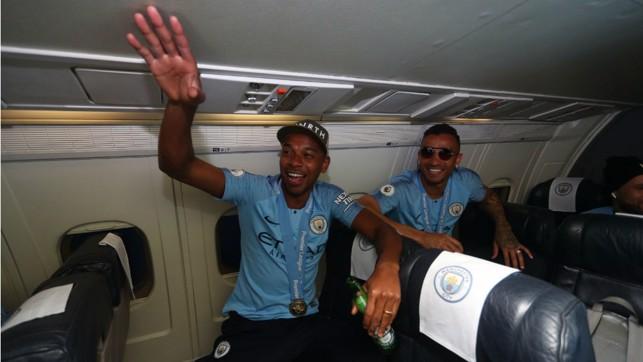 BRAZILIAN BLEND : Even at 30,000 feet Fernandinho and Danilo are still full of the party spirit